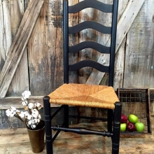 Black distressed ladder back chair