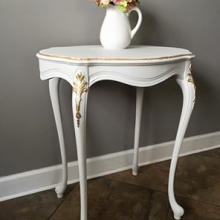 Solid wood hand painted table with gold leaf accents