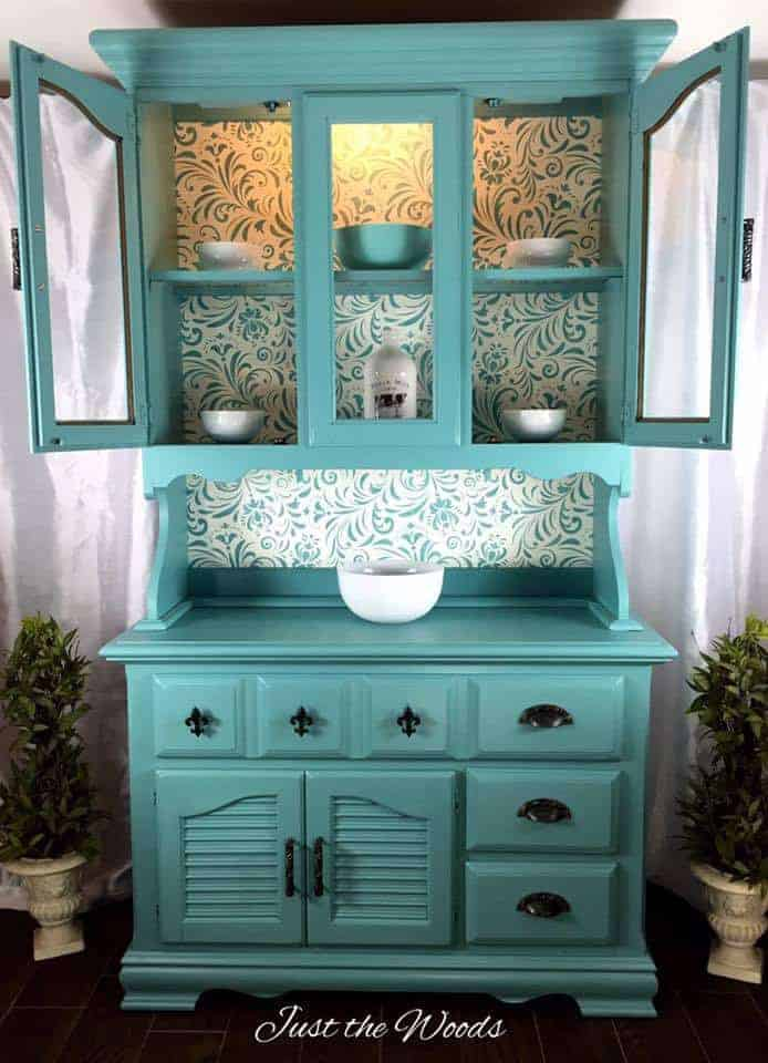 Painted sea foam china cabinet with stencil backing by Just the Woods