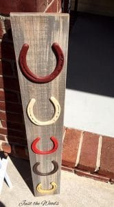 weathered wood and horse shoe display