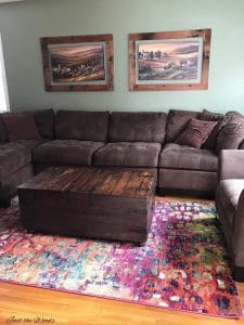 Brown living room, colorful sofa