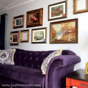 gallery-wall-over-purple-sofa, gallery wall, ornate frames