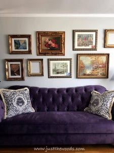 purple-sofa, gallery wall, new frames, vintage style museum style