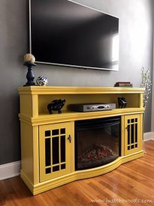 yellow-furniture-on-gray-wall, yellow painted furniture, electric fireplace, media center, new york