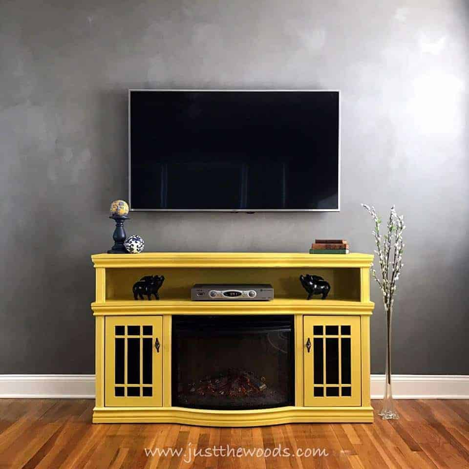 diy, tv stands, media console, tv console, painted yellow tv stand with electric fireplace on cloudy gray wall
