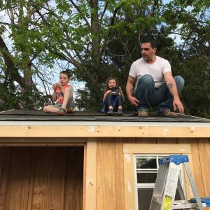 kids-on-roof, adding shingles to roof, build a shed roof