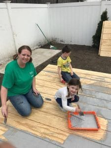 painting-shed-walls-with-brush, painting with kids
