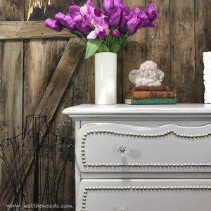 silver-studs-trim-on-dresser-drawers, faus flowers, staging props, home decor