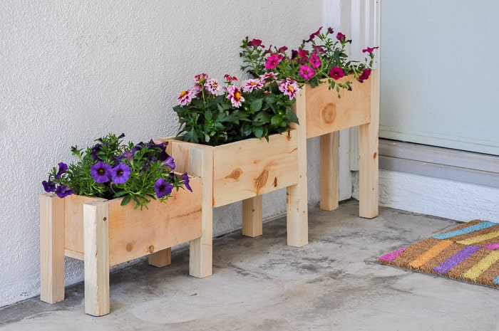 Gardening with kids 20 diy outdoor planters by just the woods easy diy tiered planter simple backyard gardening garden with kids growing vegetables and raised garden beds in a workwithnaturefo