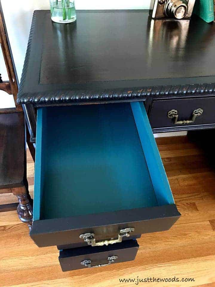 How to Save the Leather Top on a Vintage Desk / vintage desk with leather top painted black with teal inside drawers
