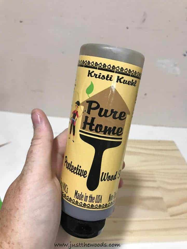pure home paint wood stain, rustic brown, See how to make a custom address sign with scrap wood, a DIY stencil, and stain. Use pre-made house numbers or stencil them yourself with this easy DIY project and Cricut. Rustic address plaque, home sign, number sign, house number sign.