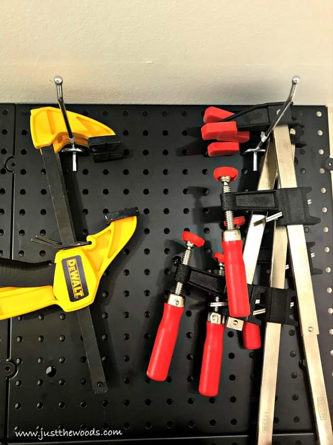 trigger clamps, woodworking clamps, pegboard tool organization ideas, pegboard tool organizer, organizing tools, pegboard wall, Tool pegboard, pegboard tool holder, pegboard tool storage, tool pegboard ideas, pegboard storage, tool hanging board, pegboards, peg board organizer