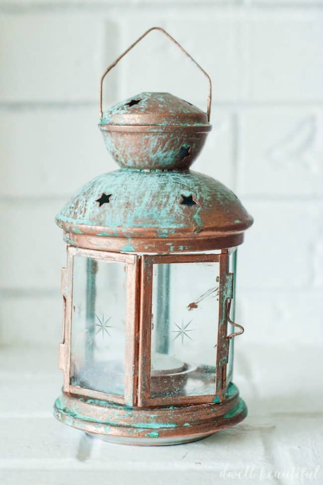 patina lanter, Patina paint projects are perfect for those who love that aged patina effect. Not everyone loves shiny and new. Some of us are more drawn to old things. Patina paint can be used to age your furniture and create a worn metallic finish. Use a patina paint job on your next DIY creation for a worn aged look. #patinapaint #patinapaintjob #copperpatinapaint