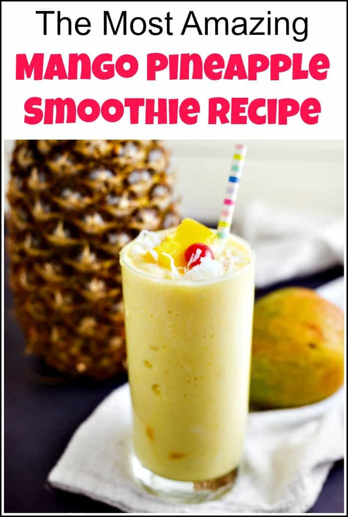pineapple mango smoothie with rainbow straw and cherry on top