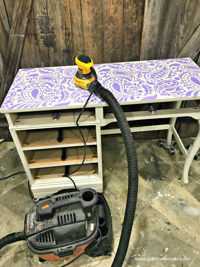 cutting edge stencils, paisley wall stencil, stencil on painted desk, sanding indoors, sander and shop vac