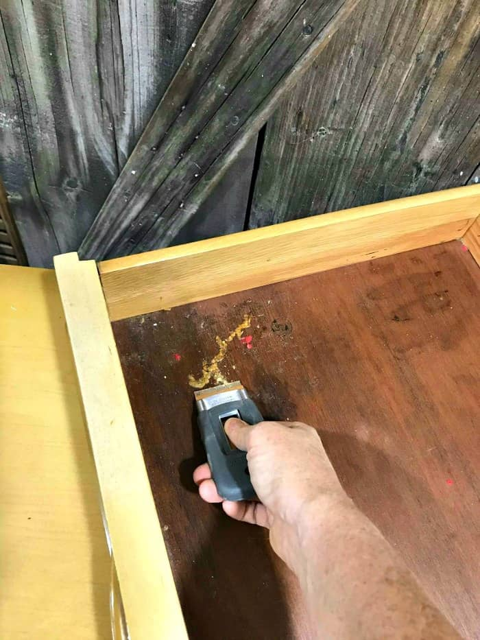 clean old wooden drawers, scrape out dirt, lemon verbena to preserve wood drawers