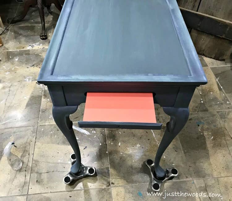 coastal painted furniture, pop of color, blue and coral painted table, painted pull out sides
