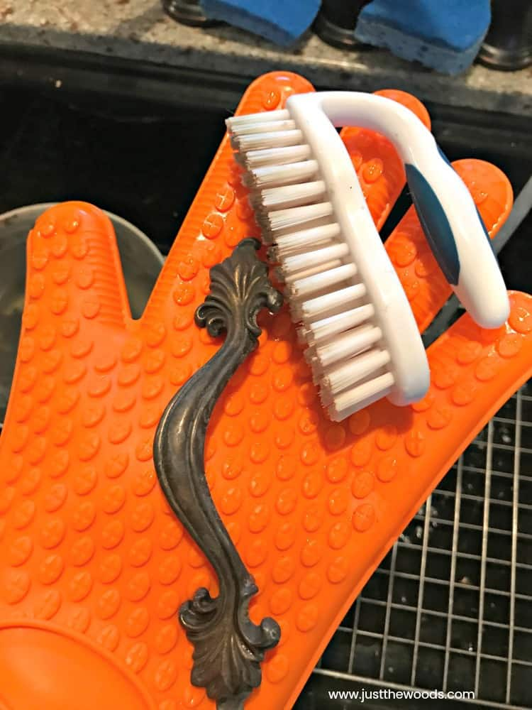 glove and scrub brush to clean old hardware