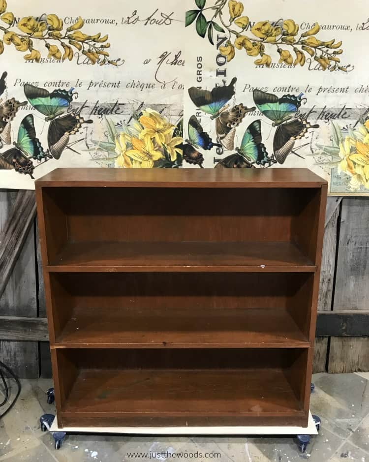 brown wood bookcase, butterfly decoupage paper