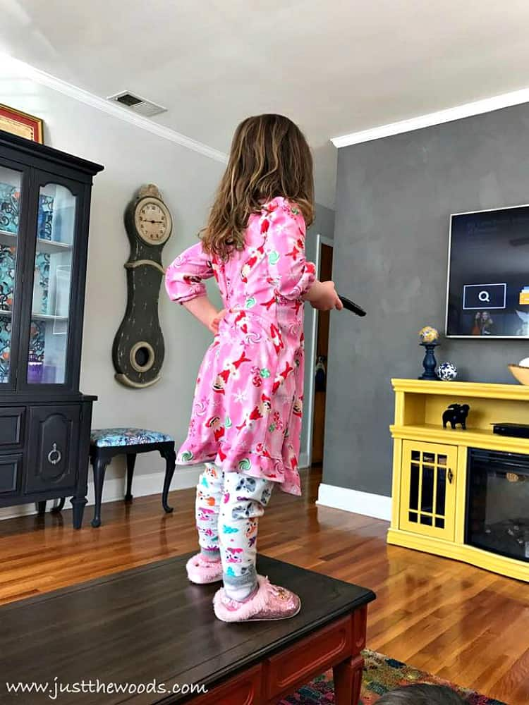girl standing on table, standing on painted furniture, repaint furniture, paint over stain