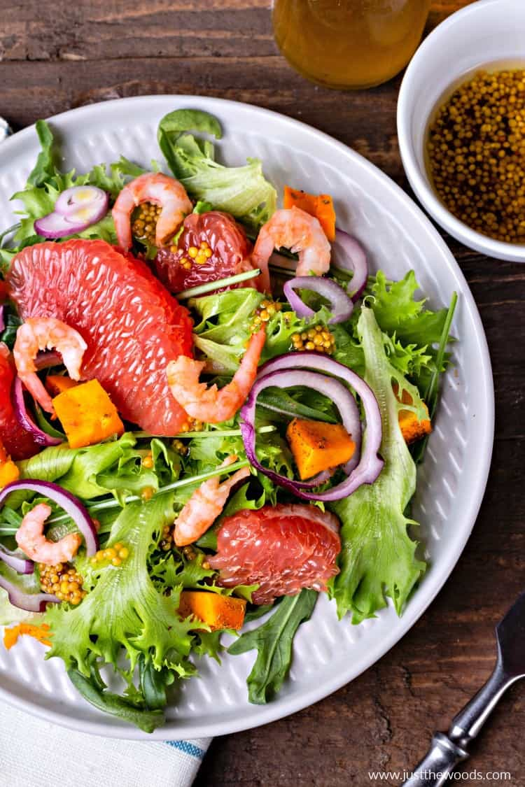 colorful healthy salad, salad with grapefruit, shrimp, arugula, squash