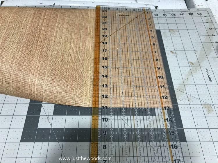 cutting mat and plastic ruler to trim paper
