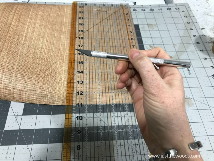 cutting mat, plastic ruler and exacto knife, sharp blade