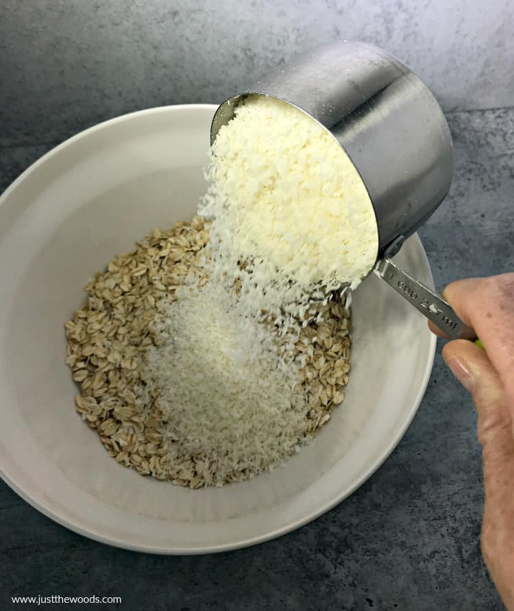 shredded coconut and rolled oats, making chocolate oat bars