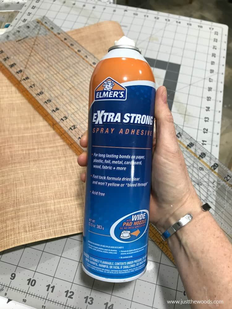 extra strong spray adhesive, blue and orange spray can
