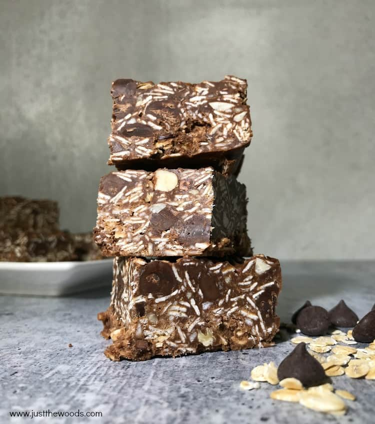 healthy peanut butter chocolate oat bars, 3 oatmeal bars stacked on one another, gray background, food photography