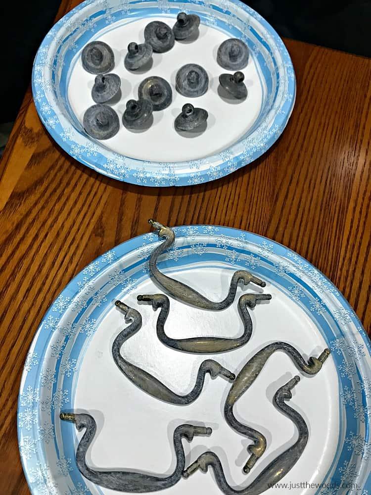 white paint on hardware, hardware on plates,
