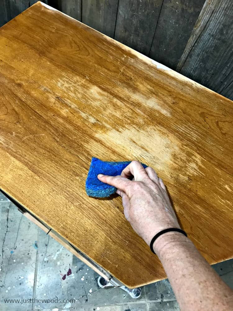 cleaning wood furniture before paint, wipe furniture with blue sponge