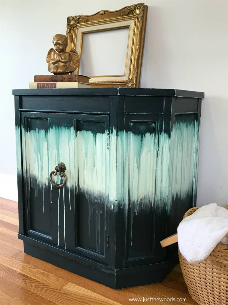side view of chalk painted furniture with drippy paint look