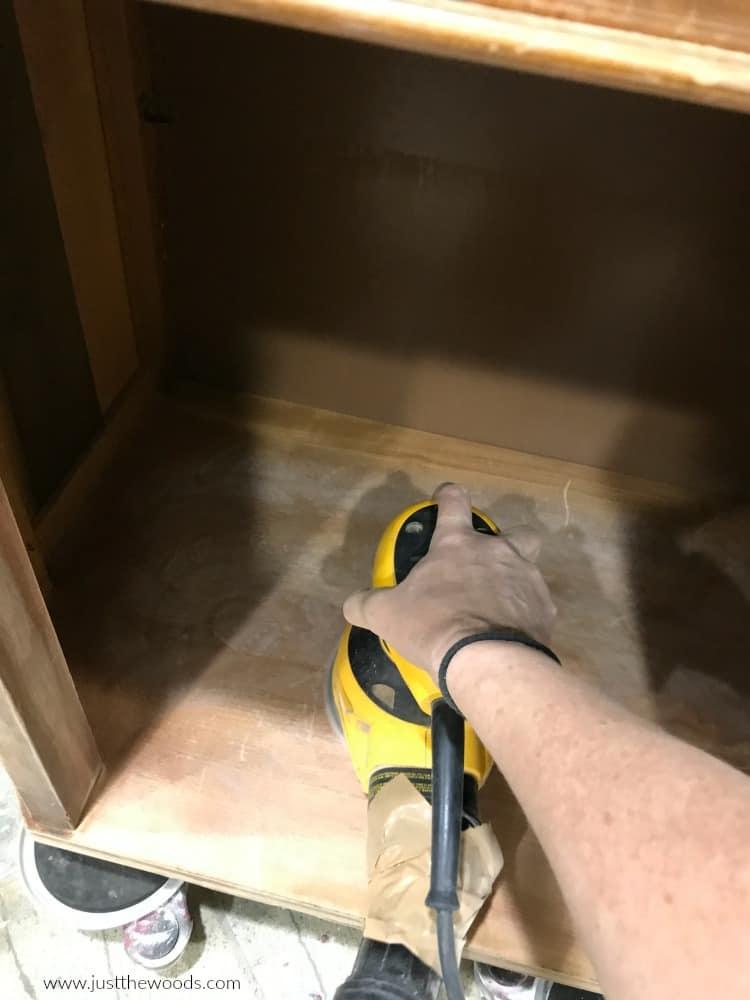 sand inside wooden cabinet