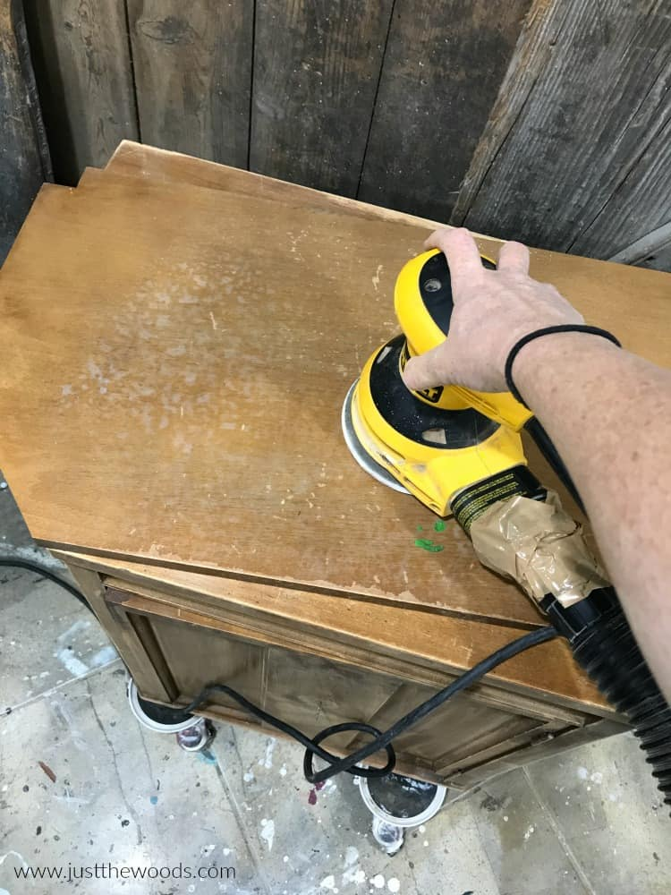 sanding wood furniture with electric sander, orbital sander