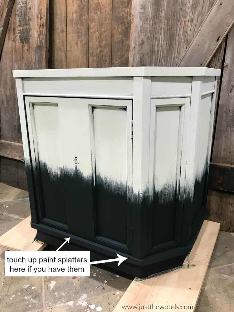 light green paint on top with dark green chalk paint on bottom of wood cabinet