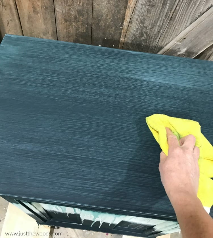 wipe sanding dust with yellow lint free cloth