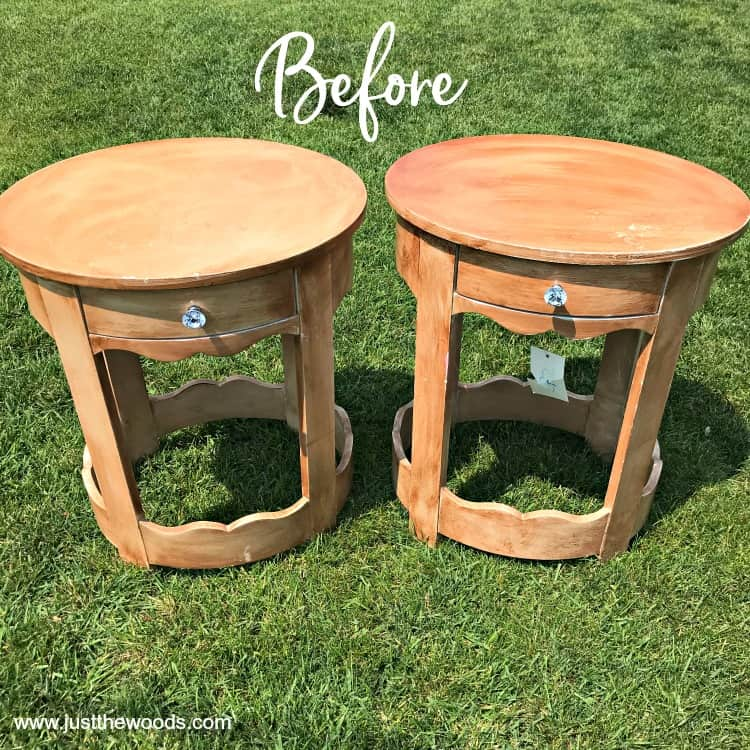 two wooden round tables on the grass before paint
