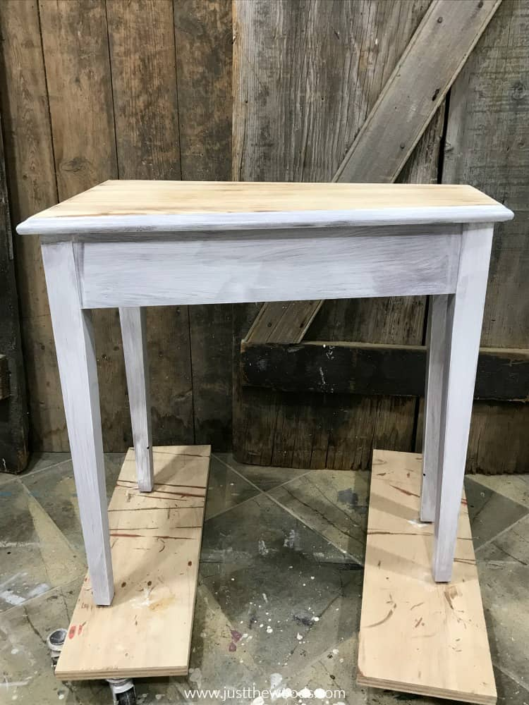 wood table painted with white primer before black furniture paint
