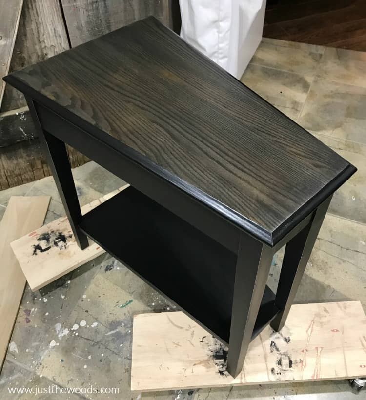 black painted table with black wood stain