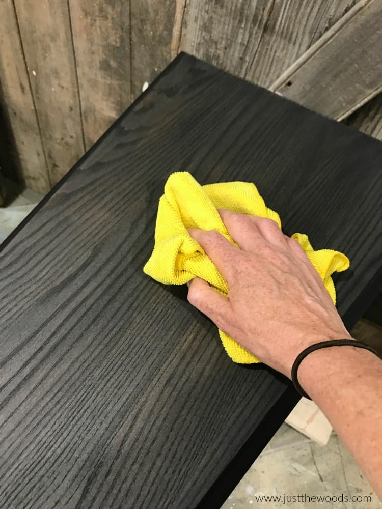 yellow cloth on black wood stain table