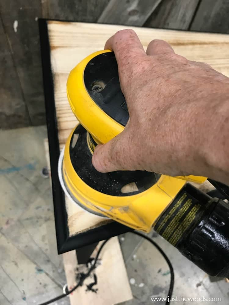 electric sander on wood to remove paint