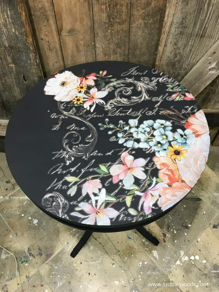 floral image on dark painted table