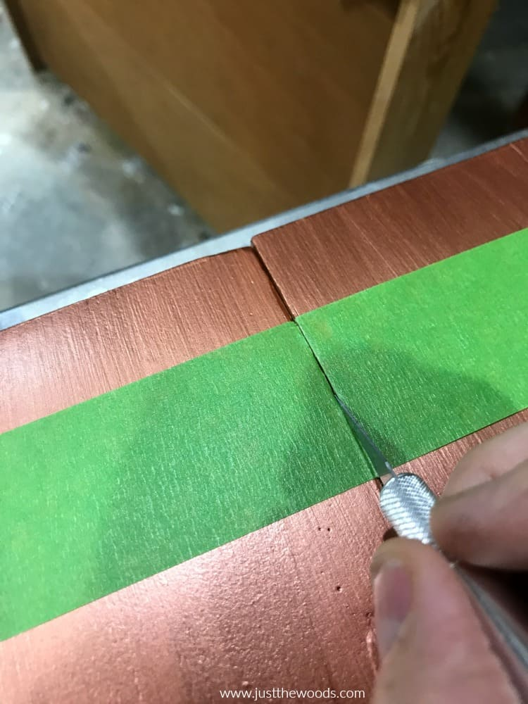 cut painters tape with blade