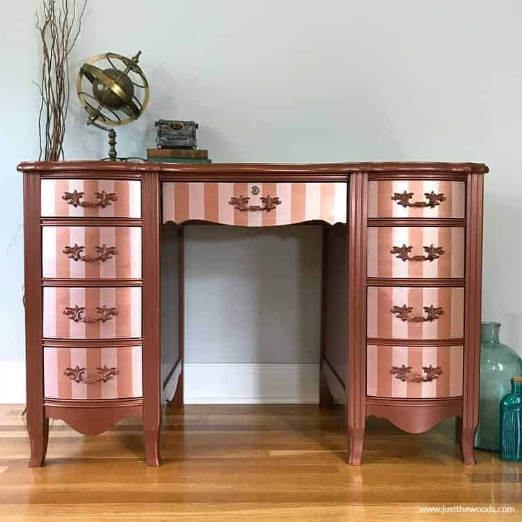 metallic painted furniture, painted desk with stripes, stripes on drawers, copper desk