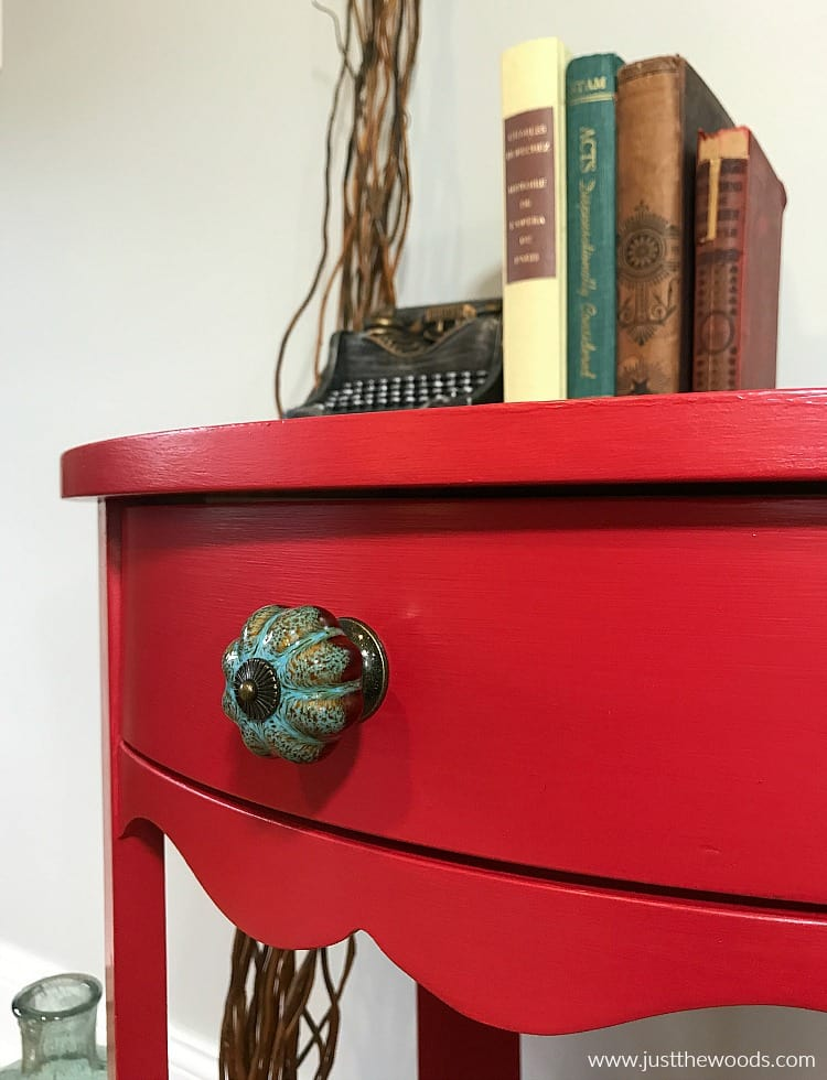 red painted drawer with blue knob, bold red painted table