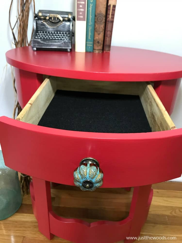 red table with blue knob, black felt liner red table