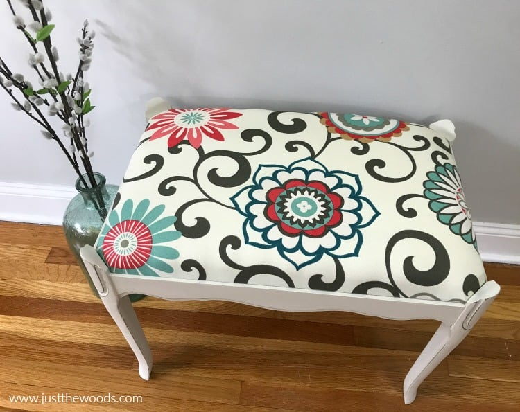 decorative fabric reupholstery on white painted bench