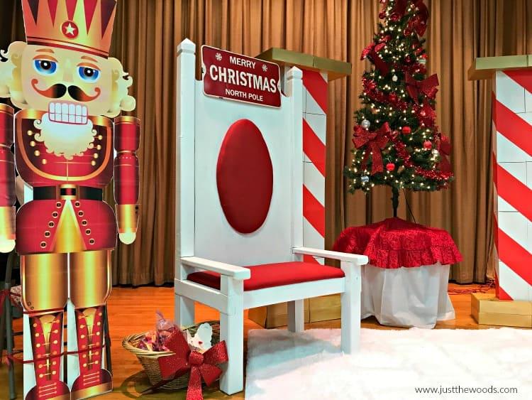 painted upholstered fabric santa chair, cardboard nutcracker statue, santa chair photos