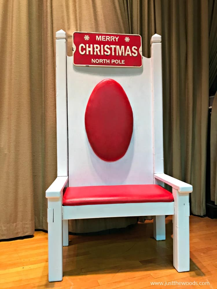 santa chair makeover with white paint on wood and red paint on fabric with metal christmas sign